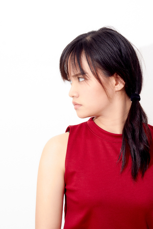 asian woman wearing a red dress face serious look toward on white background