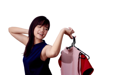 asian girl.Female.woman is fun to choose clothes.shopping clothes.beautiful dress.on white backgroundasian girl.Female.woman is fun to choose clothes.shopping clothes.beautiful dress.on white background