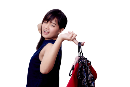 asian girl.Female.woman is fun to choose clothes.shopping clothes.beautiful dress.on white background