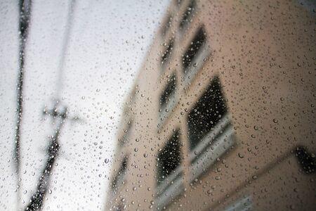 Rain drops on a car window, In the city