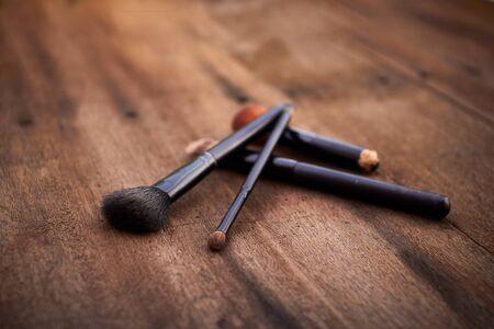 set of brushes for makeup.rouge/brusher, Brush Set on wood brown background