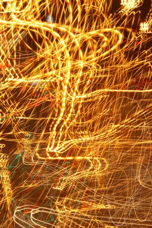 The messy yellow gold. Light at night. Abstract.