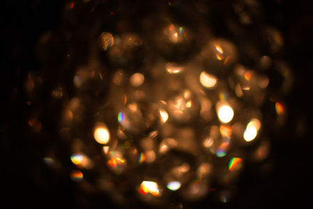 Bokeh gold from the chandelier ceiling lamps, light from the tube. 스톡 콘텐츠