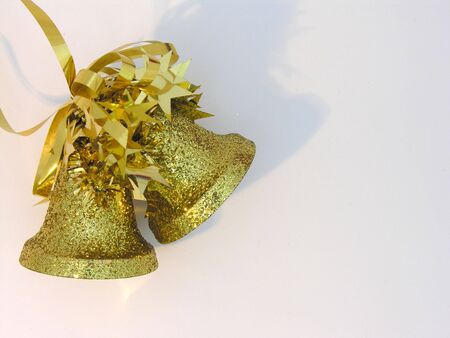 christmas tide: Gold bells christmas decoration on a white background. Stock Photo