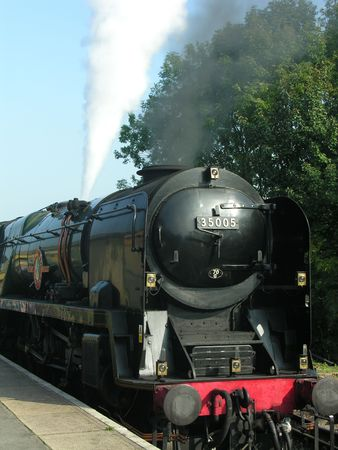 A steam train blowing steam