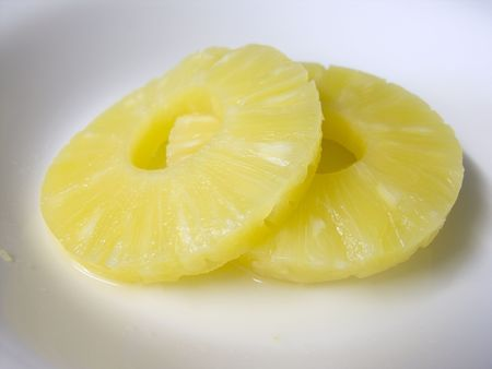 Slices of pineapple on a white plate