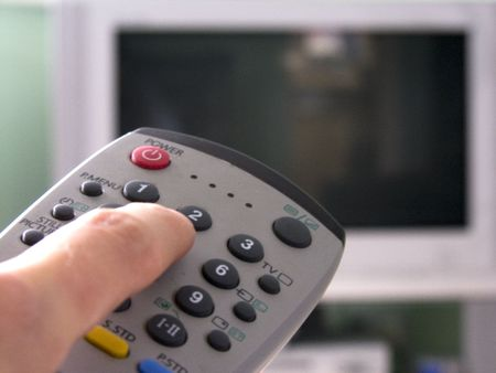 A remote control pointing at the tv