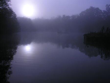 Moonlight over a calm lake Stock Photo