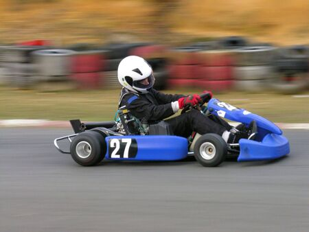 A speeding blue go kart Stock Photo