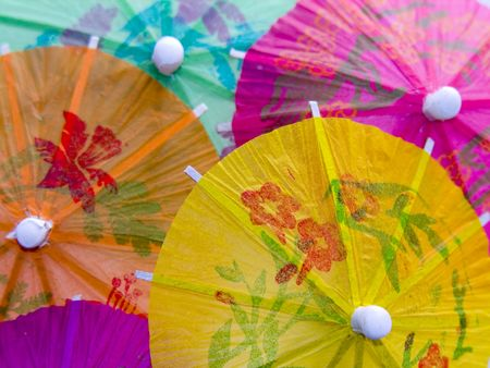 A closeup shot of some colourful cocktail umbrellas Stock Photo
