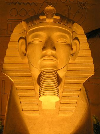 An Egyptian head mask carving out of stone
