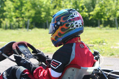 carting: The back of a go-karters helmet