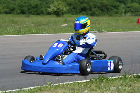 A blue adult 100CC go kart