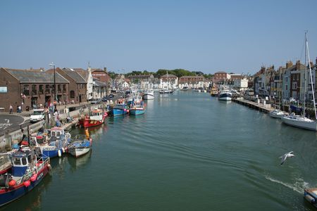buoys: The old harbour at Weymouth, Dorset in England. Stock Photo