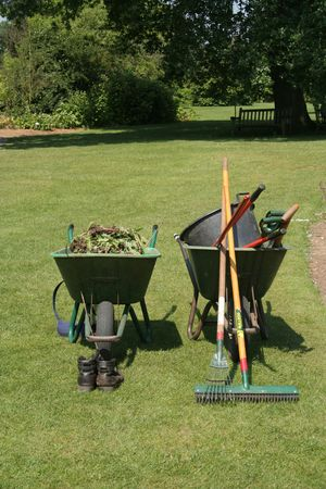 A variety of gardening tools in two wheel barrows