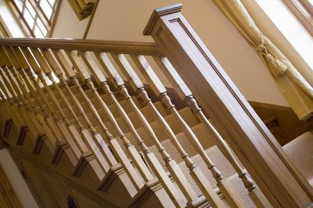 hand rails: An angled shot of some wooden stairs