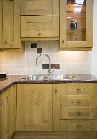 Part of a wooden kitchen with a stainless steel sink Stock Photo - 744967