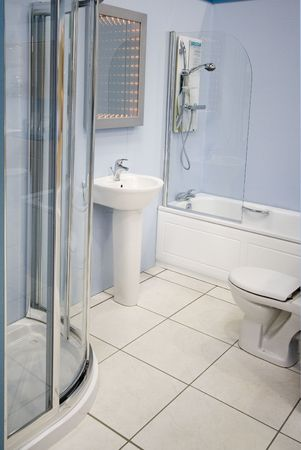 A modern spacious bathroom suite Stock Photo