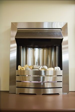 A modern fireplace with a metal surround Stock Photo