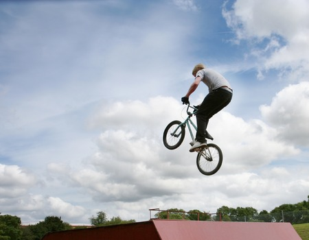 showoff: A stunt rider doing high jumps on a bmx bicycle