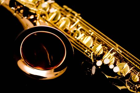 the tenor: Section of Saxophone with very shallow depth of field. This is a Tenor saxophone.