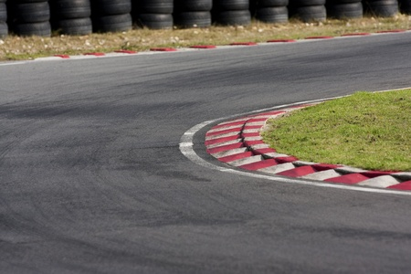 on track: An empty bend on a race car circuit.