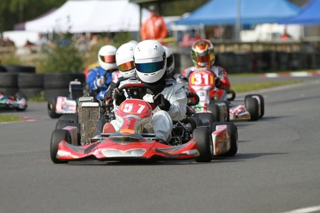 kart: A line of racing go karts in a race