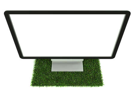 Monitor on grass with white background and top view photo
