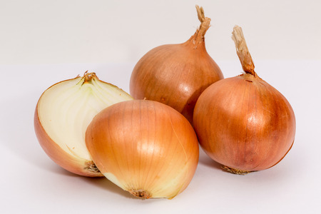 bisected: Shallots on white background. whole and bisected.