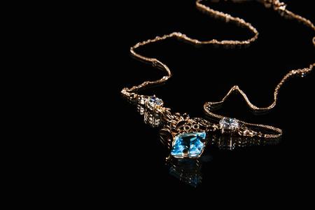topaz: Golden necklace with topaz gemstone