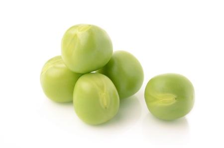 Green peas on white background