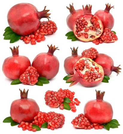 Juicy pomegranate on white background photo