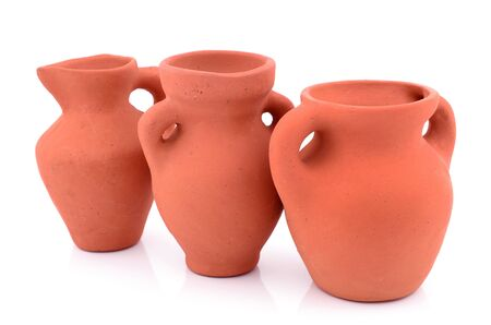 Clay jugs on a white background photo