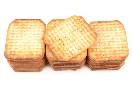 writing western: crispy crackers with spices isolated on a white background