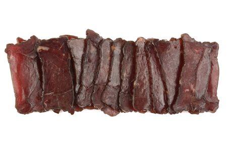 very tasty beef jerky on a white background
