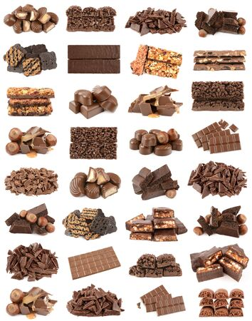 sweet segments: Chocolate and hazelnuts isolated on a white background