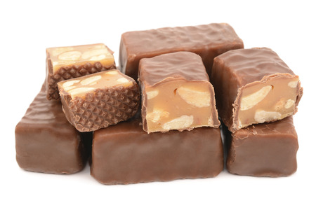 candies with nougat and peanuts on a white background