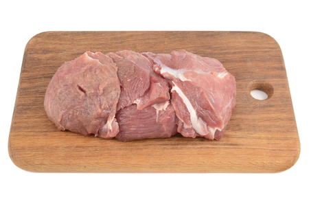 fresh piece of veal on the board and on a white background