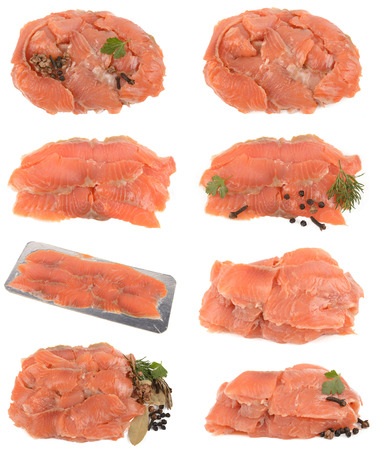 Tasty and useful pieces of salmon on a white background