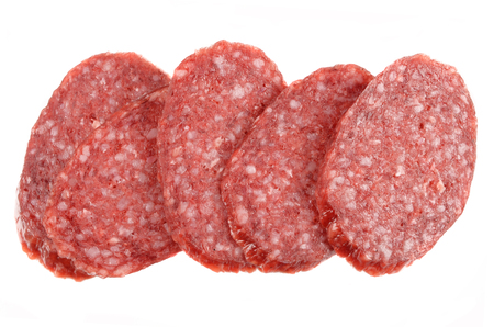 Sliced fresh salami isolated on white background Stock Photo