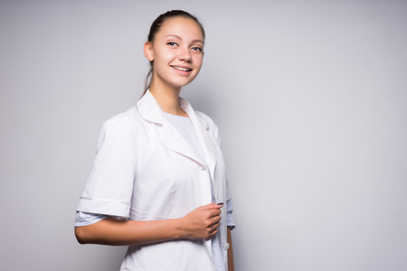 Young female doctor smiling, wearing a bathrobe