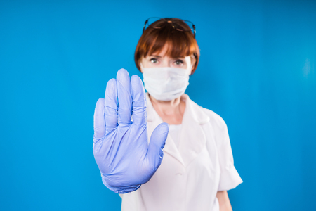 woman doctor shows hand gesture stop, is forbidden