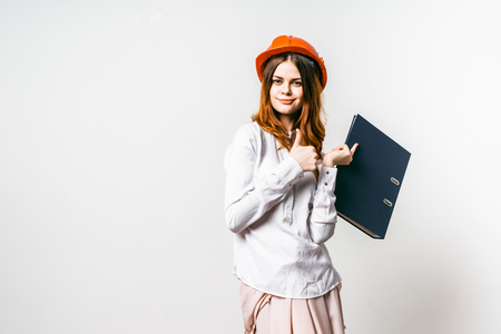 young girl in a red hat holds a folder with documents