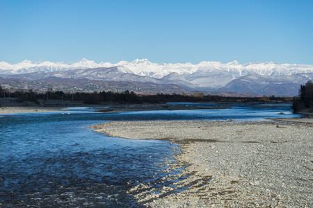 the mountain river flows against the background of the mountains 스톡 콘텐츠