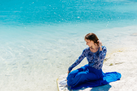 skirts: Freedom woman in free happiness bliss on beach. Smiling happy multicultural female model in summer dress enjoying serene ocean nature during travel holidays vacation outdoors,sitting.Dental.