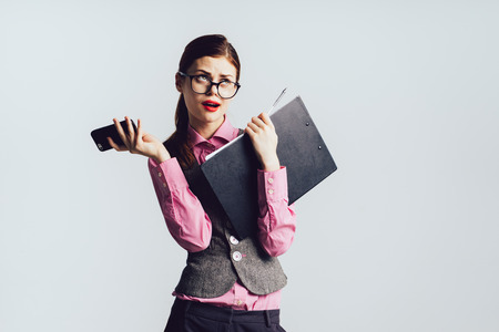 Business woman in problems, stress, hands with phone and papers, do not have time Stockfoto