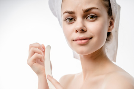 filings: girl after shower with a towel on her head cute smiling, and filings nails Stock Photo