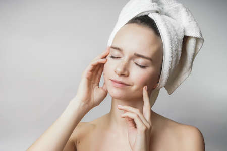 Enjoying charming woman touch clean face, after shower
