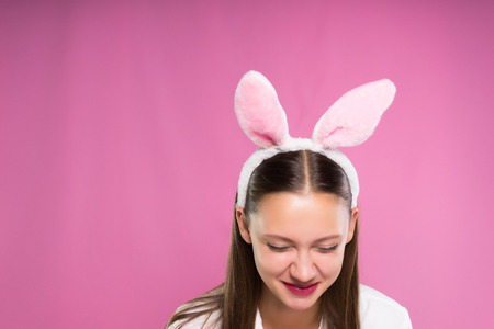 a girl with a nice rim in the form of hares ears laughs