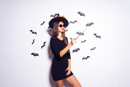 Halloween Party girl. Happy Halloween Sexy girl,  Beautiful young surprised woman in witches hat